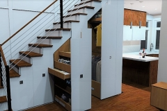 Under Staircase Storage 3d Rendering of The Modern Farmhouse Plan